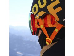 A rider wearing an Out Of Earth ski goggle under his wipeout helmet