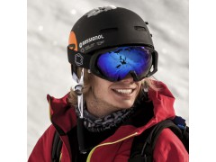 A freerider wear an Out Of Edge ski goggle over his wipeout helmet during a backcountry session