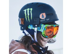 A girl wearing an Out Of Eyes ski goggle under his Wipeout helmet