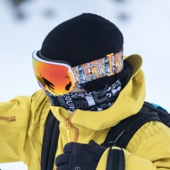 An Out Of rider wearing an open ski goggle during a freeride session