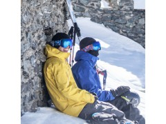Two riders relazing in the backcountry wearing two Out Of Open ski goggles