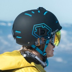 A rider wearing an Out Of Open ski goggle under his wipeout helmet.