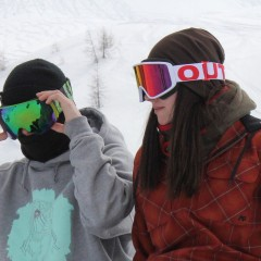Two riders wearing their Out Of ski goggles Open and Shift