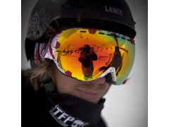 Potrait of a rider wearing an Out Of Eyes ski goggle under his wipeout helmet