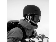 A rider wearing an Out Of Shift ski goggle under his wipeout helmet