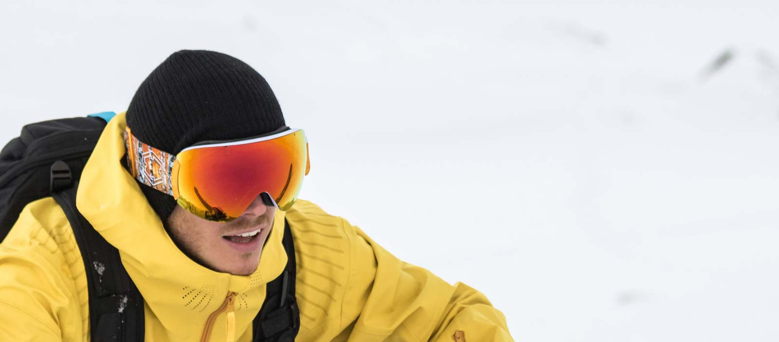 A freerider climbing wearing an Out Of Open ski goggle